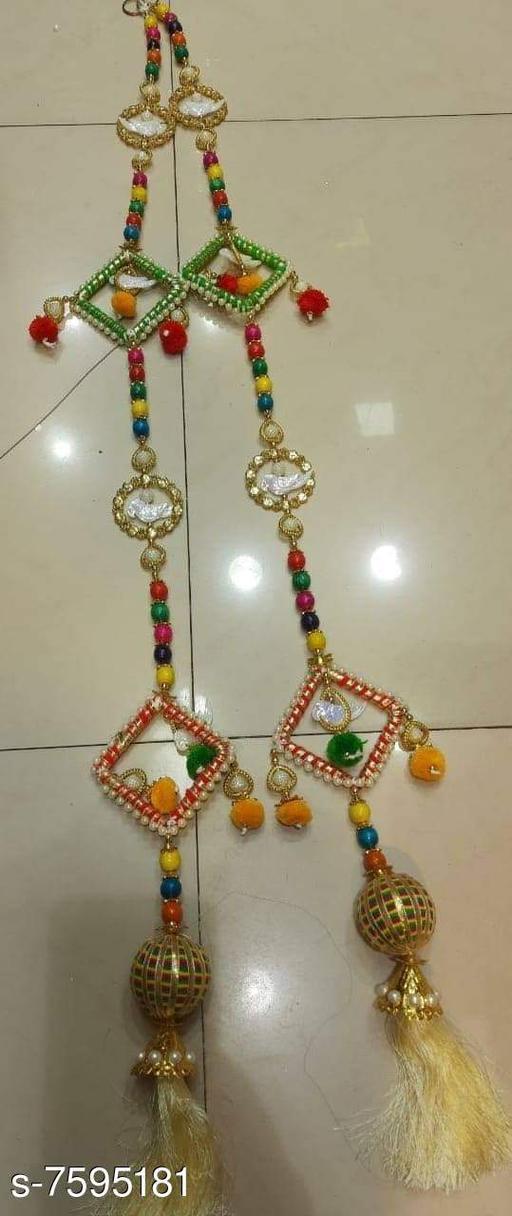 Toran & Wall Hangings TORAN AND HANGINGS  *Material* Handicraft  *Pack* Pack of 2  *Sizes Available* Free Size *    Catalog Name: Trendy Festive Toran CatalogID_1229214 C128-SC1318 Code: 953-7595181-