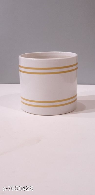 Table top ceramic shape planter, available in White color with self design in Gold