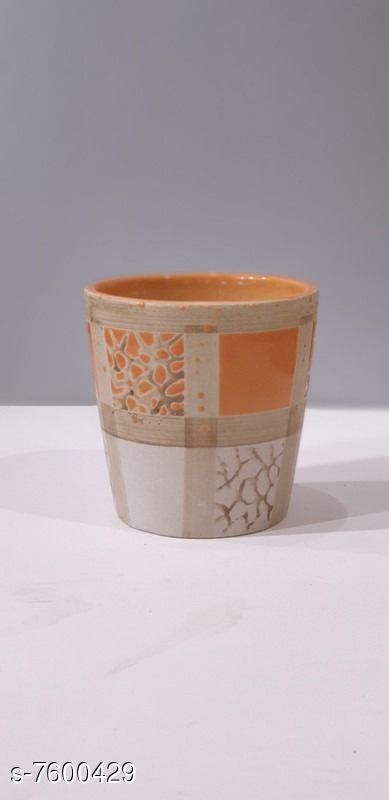 Table top ceramic planter with embossed sprinkled color shades, available in Peach/Light orange pattern