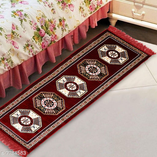 Carpets & Dhurries  *NFI essentials Bed Side Runner Mat | Floor Runner | Kitchen Mat in Velvet Material | Size * 51x168  *Material* Velvet  *Pattern* Ethnic Motifs  *Multipack* 1  *Sizes*   *Free Size (Length Size* 51 cm, Width Size  *Sizes Available* Free Size *    Catalog Name: Trendy Attractive Floormats & Dhurries CatalogID_1271335 C55-SC1119 Code: 725-7784583-055