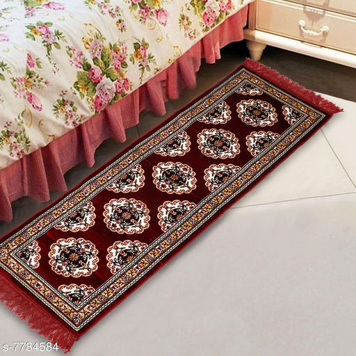 Carpets & Dhurries  *NFI essentials Bed Side Runner Mat | Floor Runner | Kitchen Mat in Velvet Material | Size * 51x168  *Material* Velvet  *Pattern* Ethnic Motifs  *Multipack* 1  *Sizes*   *Free Size (Length Size* 51 cm, Width Size  *Sizes Available* Free Size *    Catalog Name: Trendy Attractive Floormats & Dhurries CatalogID_1271335 C55-SC1119 Code: 725-7784584-055