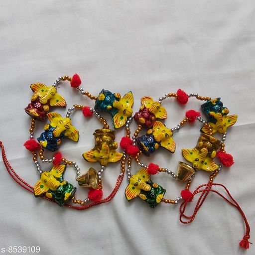 Wind Chimes Traditional Ganesha Wall Door Hanging  *Material* Handicraft  *Pack* Pack of 2  *Sizes Available* Free Size *    Catalog Name: Colorful Chimes CatalogID_1444157 C127-SC1619 Code: 652-8539109-