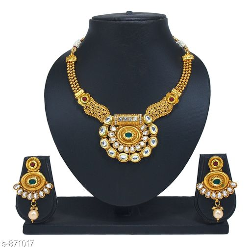 Jewellery Set Ethic Copper Alloy Stone Gold Plated Bridal Jewellery Set  *Material* Copper Alloy & Stones  *Size* Free Size  *Description* It Has 1 Piece Of Necklace And 1 Pair Of Earrings  *Finishing* Gold Plated  *Work* Bridal & Stones  *Sizes Available* Free Size *   Catalog Rating: ★4.1 (87)  Catalog Name: Copper Alloy Stone Gold Plated Bridal Jewellery Sets CatalogID_101301 C77-SC1093 Code: 414-871017-