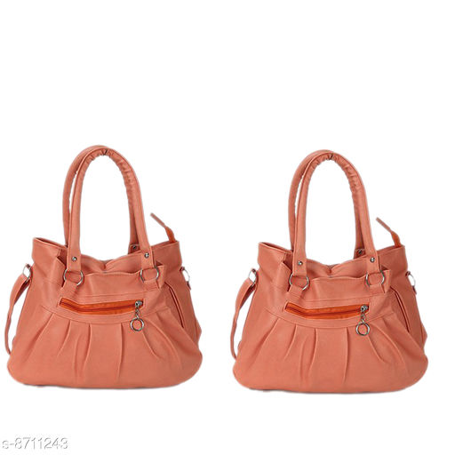 Handbags Mountrex Present This Peach Color Premium Quality stylish girl handbag for girls fashion HandBags ( PACK OF 2 )  *Material* PU  *No. of Compartments* 2  *Pattern* Solid  *Type* Handheld  *Multipack* 2  *Sizes* Free Size (Length Size Mountrex Present This Blue Color Premium Quality stylish girl handbag for girls fashion HandBags ( PACK OF 2 ) ***** Attractive and Elegant -Women Hand Bag is a combination of elegance and durability. It portrays a chic and eye-catchy look and will undoubtedly add a layer of sophistication to your personality. Hand bags for women are perfect accessory to invest in! Suitable for everyday use - handbags are inspired from latest trends and fad. From college to office and parties to shopping, you can carry it anywhere in a hassle free manner and spruce up your overall look. These women bags lend a chic and stylish look. Flaunt your feminine charm and stand out from the crowd! Women fashion Handbags are capacious enough to store all your daily belongings such as lipsticks, documents, cards and other cosmetic materials. Carry your world in style with this PU leather Handbag.  *Sizes Available* Free Size *    Catalog Name: Graceful Classy Women Handbags CatalogID_1484854 C73-SC1073 Code: 236-8711243-9951