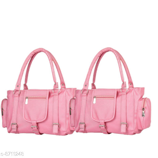 Handbags Mountrex Present This Baby Pink Color Premium Quality stylish girl handbag for girls fashion HandBags ( PACK OF 2 )  *Material* PU  *No. of Compartments* 2  *Pattern* Solid  *Type* Handheld  *Multipack* 2  *Sizes* Free Size (Length Size Mountrex Present This Blue Color Premium Quality stylish girl handbag for girls fashion HandBags ( PACK OF 2 ) ***** Attractive and Elegant -Women Hand Bag is a combination of elegance and durability. It portrays a chic and eye-catchy look and will undoubtedly add a layer of sophistication to your personality. Hand bags for women are perfect accessory to invest in! Suitable for everyday use - handbags are inspired from latest trends and fad. From college to office and parties to shopping, you can carry it anywhere in a hassle free manner and spruce up your overall look. These women bags lend a chic and stylish look. Flaunt your feminine charm and stand out from the crowd! Women fashion Handbags are capacious enough to store all your daily belongings such as lipsticks, documents, cards and other cosmetic materials. Carry your world in style with this PU leather Handbag.  *Sizes Available* Free Size *    Catalog Name: Graceful Classy Women Handbags CatalogID_1484854 C73-SC1073 Code: 236-8711248-9951