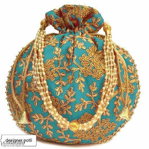Pouches & Potlis NavratriLAX_105  *Material* Fabric  *Multipack* 1 NA  *Sizes*  Free Size  *Sizes Available* Free Size *    Catalog Name: Graceful Versatile Women Pouches & Potlis CatalogID_1683483 C73-SC1077 Code: 702-9545887-