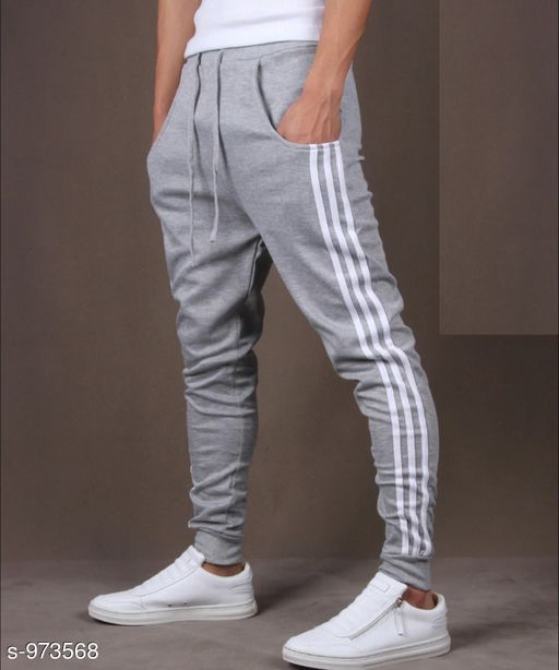 Track Pants Men's Casual Solid Track Pant  *Fabric* Spun Blend  *Waist Size* S - 28 in, M - 30 in, L - 32 in, XL - 34 in, XXL - 36 in  *Length* Up to 38 in  *Type* Stitched  *Description* It Has 1 Piece Of Men's Track Pant  *Pattern* Solid  *Sizes Available* S, M, L, XL, XXL *   Catalog Rating: ★3.9 (11111)  Catalog Name: Mens Casual Solid Track Pants Vol 5 CatalogID_115274 C69-SC1214 Code: 392-973568-