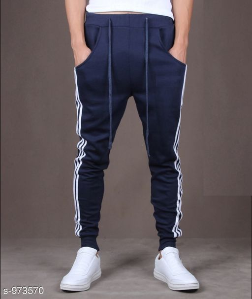 Track Pants Men's Casual Solid Track Pant  *Fabric* Spun Blend  *Waist Size* S - 28 in, M - 30 in, L - 32 in, XL - 34 in, XXL - 36 in  *Length* Up to 38 in  *Type* Stitched  *Description* It Has 1 Piece Of Men's Track Pant  *Pattern* Solid  *Sizes Available* S, M, L, XL, XXL *   Catalog Rating: ★3.9 (11080)  Catalog Name: Mens Casual Solid Track Pants Vol 5 CatalogID_115274 C69-SC1214 Code: 692-973570-